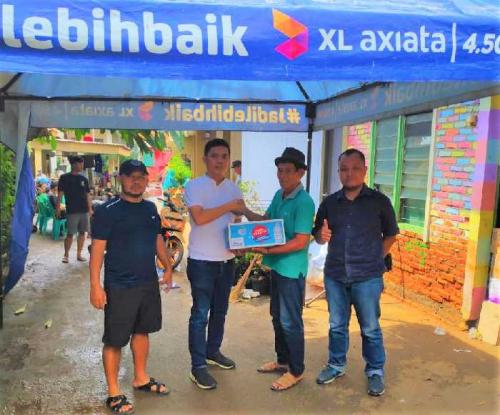 Peduli Bencana Banjir di Jabodetabek, XL Axiata Salurkan Bantuan untuk Korban Banjir