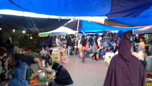 Tak Ada Jual di Apotek, Pedagang dan Pembeli di Pasar Panam Tak Pakai Masker